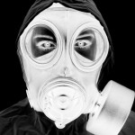 black and white negative representation of woman wearing gas mask and protective clothing